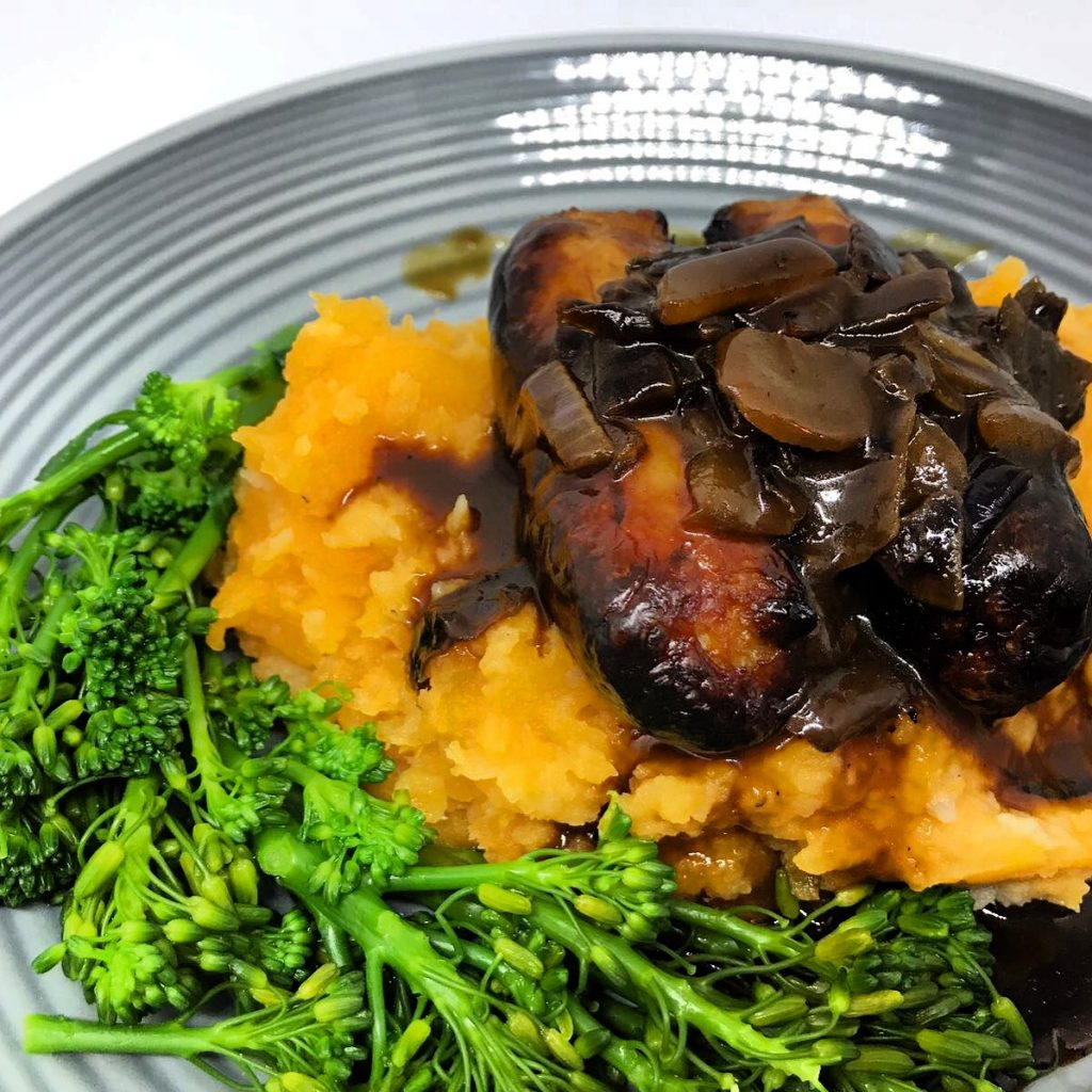 honey mustard sausages with sweet potatoe mash and sticky red onion gravy